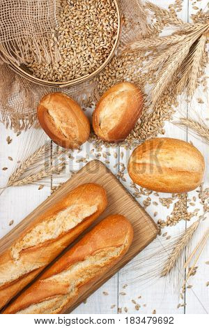 Assortment of baked bread on wooden board