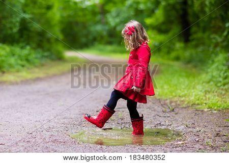 Little Girl Walking In The Rain