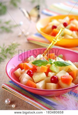 Delicious fruits salad in plate. Close up