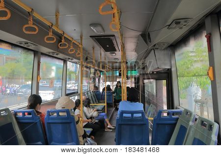 HO CHI MINH CITY VIETNAM - DECEMBER 2, 2016: Unidentified people take local bus.