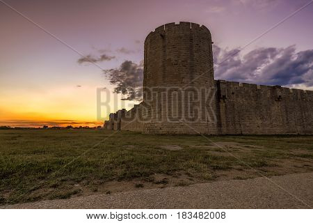 Sunset over the wall in old city Aigues-Mortes, Provence, France.