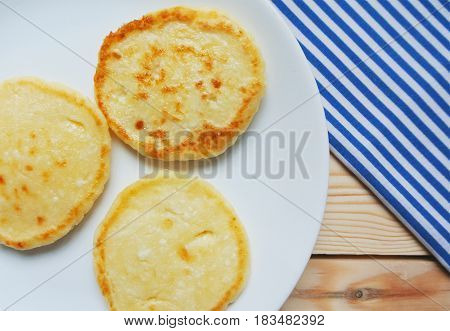 Russian style breakfast syrniki or cottage cheese pancakes.