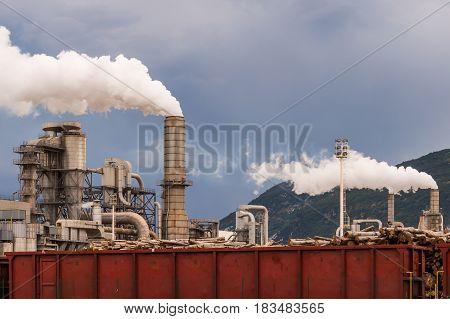 Industrial plant. Smokestacks storage tanks and rail wagon. Lumber industry poster