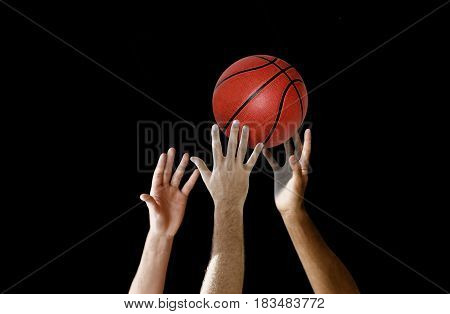 Players hand reaching for basketball in a competition