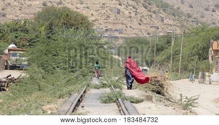 Woman and child walk in Ethiopian desert near Somalia