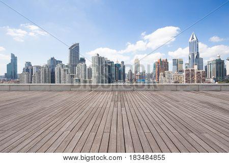 landmark buildings in midtown of shanghai from empty wooden floor