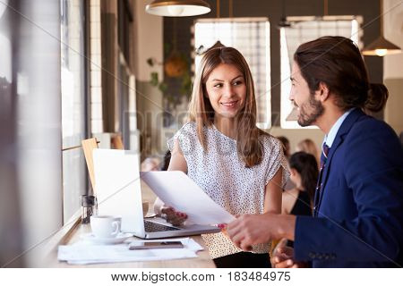 Two Businesspeople Having Informal Meeting In Coffee Shop