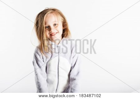 Cute Little Girl In Pajamas Jumping And Having Fun In Bed At Home.