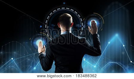 business, people, technology and cyberspace concept - businessman in suit working with virtual screen and diagram charts over dark background
