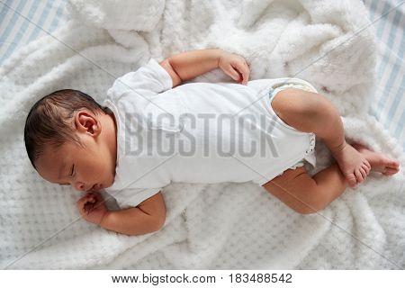 Newborn Baby Sleeping In Nursery Cot