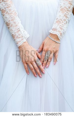 jeweler bracelet and rings on the bride's hand