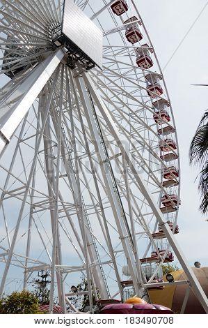 Tel Aviv Israel April 16 2016 : Visitors to the city's attractions park ride on the ferris wheel in Tel Aviv Israel