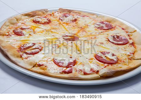 Tasty Pizza With Salami On White Plate. White Background
