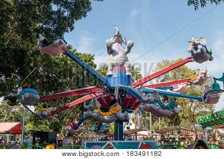 Tel Aviv Israel April 16 2016 : Visitors to the city's attractions park ride on the carousel in Tel Aviv Israel