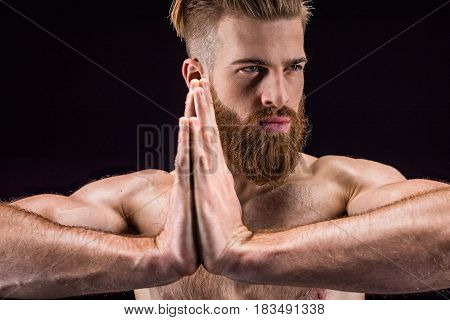 Man In Yoga Pose With Namaste Gesture  Isolated On Black