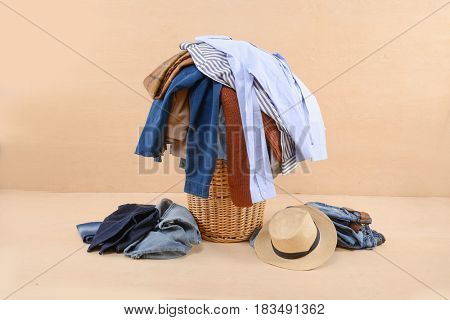 full of jeans, clothes ,hat,shirt in Basket-wooden background