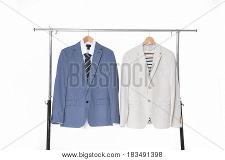 Two man suit ,Shirts with ties on wooden hangers