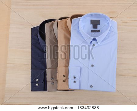 Four man shirt on wooden background