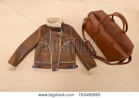 Jacket clothes with bag –wooden background