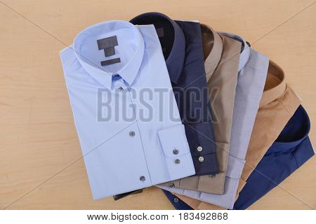 Business classic men's shirts with different prints.-wooden  background