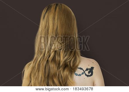 Young Adult Woman Back with Tattoo Studio Portrait
