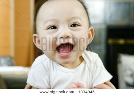 Close Up Of Baby Boy Laughing