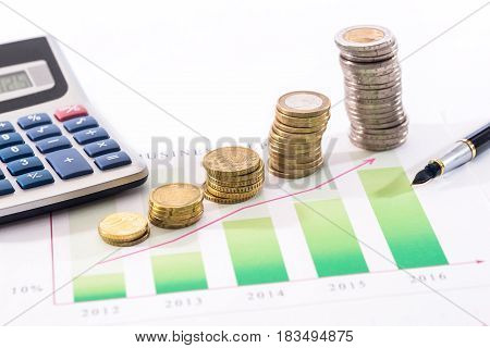 business graph euro coin calculator and pen isolated