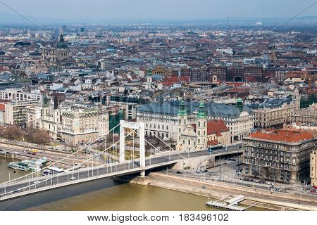 Budapest, Hungary - March 12, 2017: View from Gellert Hill to Pest side with Erszebet bridge over Danube river by day in Budapest, Hungary