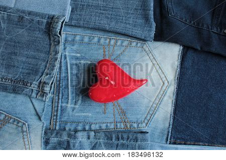 Blue jeans detail and red heart candle/ These are kind of blue jeans and red heart candle.