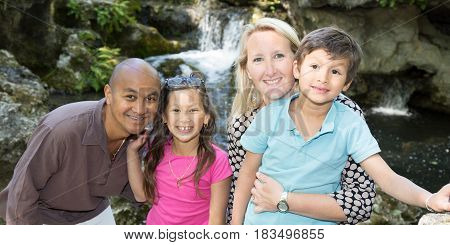 Mixed Family Multiracial With A Blond Caucasian Woman And An Indian Man With Their Two Children Meti