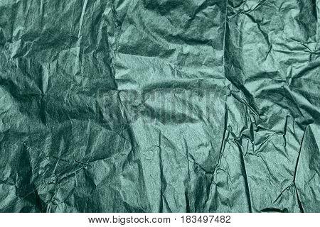 green crumpled paper. Pearl green crumpled texture.