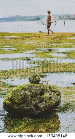 Zen-like Stones Covered with Moos on Beach during Low Tide, Nice Water Reflection, Nusa Dua, Bali, Indonesia.