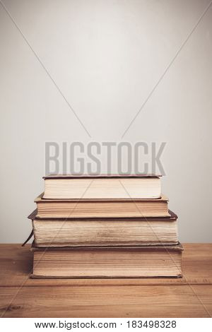 Book lying on a table with a white background