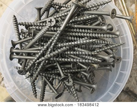 Metal Steel Black Screws For The Abstract Background