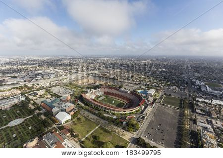 Los Angeles, California, USA - April 12, 2017:  Aerial view of the historic Coliseum with afternoon clouds.
