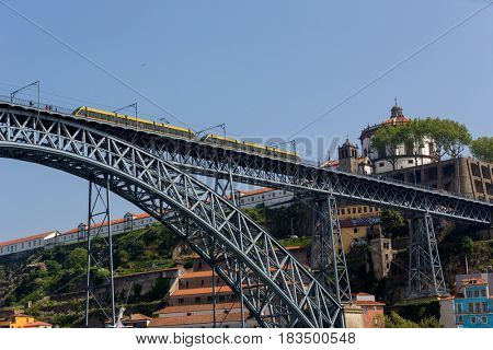 PORTO, PORTUGAL - APRIL 17: Dom Luis Bridge, Ponte Luis I with metro train, Porto, Portugal in Portugal on April 17, 2017.