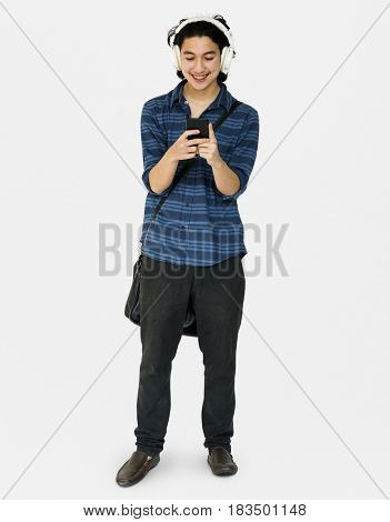 Young man full bordy listening music on smart phone