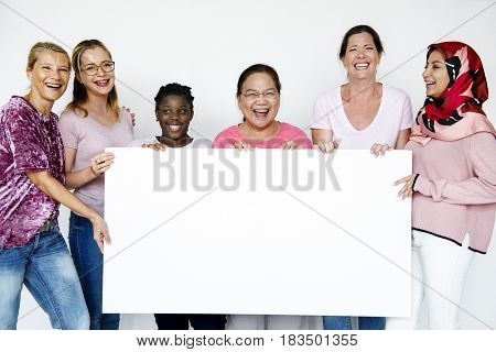 Group of women holding empty board for advertising