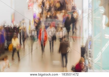 Abstract blurred image of shopping, people walking in exhibition, exhibition - trade fair show