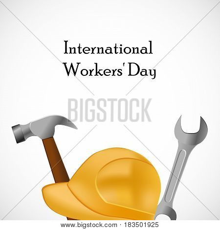 Illustration of helmet with hammer and spanner with International Worker's Day text