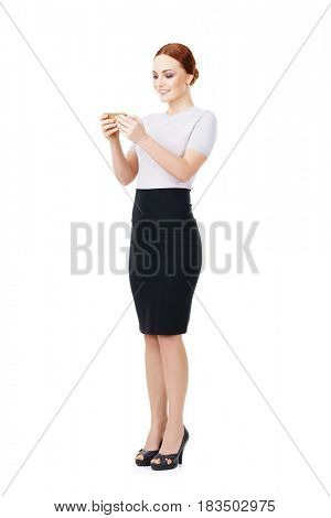 Young, confident, successful and beautiful business woman with smartphone isolated on white. Occupation, career, job concept.