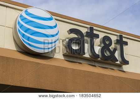 Marion - Circa April 2017: AT&T Corporate logo and signage on a mobility store. AT&T now offers Uverse VoIP Cell Phones and DirecTV XVI