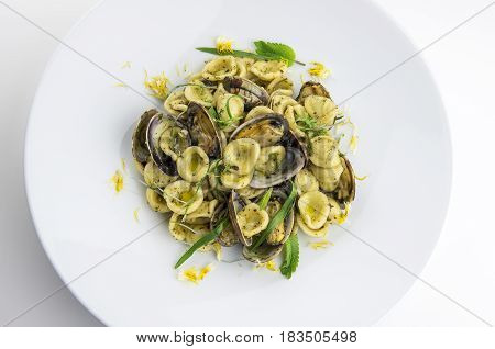 Top view of Pasta dish Apulian ears with clams