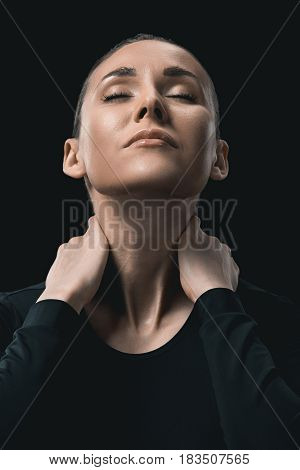 Tired Young Fitness Woman Stretching Neck Isolated On Black.