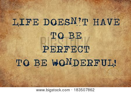 Inspiring motivation quote with typewriter text life doesn't have to be perfect to be wonderful. Distressed Old Paper with Typing image.