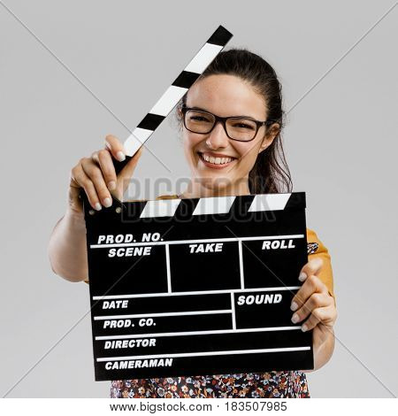 Portrait of beautilful woman holding a clapboard