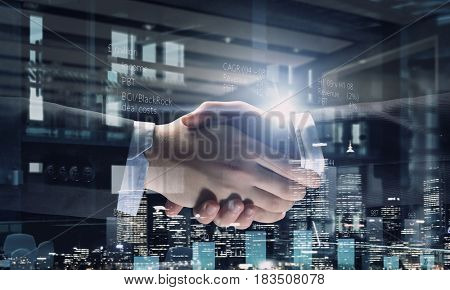 Partners shaking hands as symbol of deal
