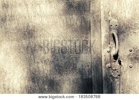 Creative Metal Background. An Old Metal Door With A Lock And A Door Handle. Flat Background Texture