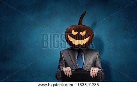Scary businessman with pumpkin head