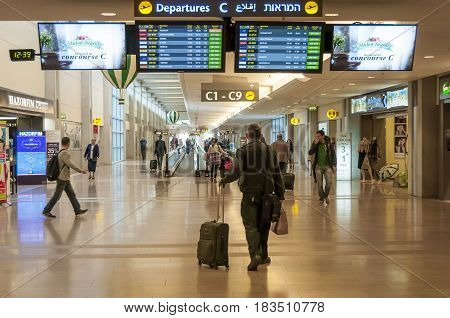 Passenger looking at the departure timetable in the Ben Gurion International Airport stock image. TEL AVIV, ISRAEL, December 2014.